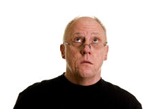 Older Bald Guy in Black Shirt Looking Up Royalty Free Stock Photo