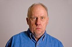 Older Bald Guy In Blue Denim Shirt Serious Royalty Free Stock Photos