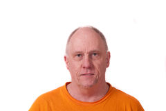 Older Bald Guy in Orange Shirt on white Royalty Free Stock Images