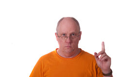 Older Bald Man in Orange Tshirt Pointing Up Stock Photo