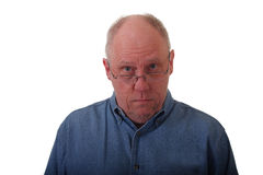 Older balding man in blue denim Royalty Free Stock Photos