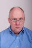 Older Balding Man in Blue Shirt. An older balding man in a blue shirt royalty free stock photos
