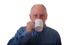 Older Balding Man in Blue Shirt Drinking Coffee Stock Photography