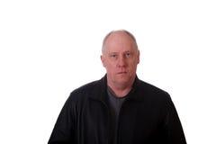 Older Balding Man In Black Jacket Serious Stock Photo