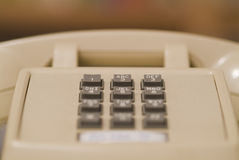 Older beige phone 03. Close up photograph of older beige telephone touch tone numbers from the center Royalty Free Stock Photo