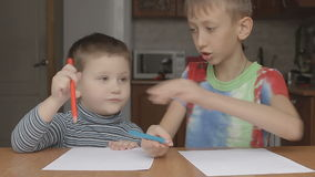 The older boy shows how to keep crayon stock footage