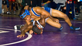Older Boys Wrestling. Two African-American boys wrestling at the Dixie Nationals Championship in Atlanta GA. These 2 are in the over 14/highschool division Royalty Free Stock Images