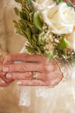 Older bride holding bouquet Royalty Free Stock Photo