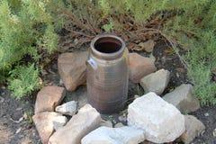 An older broken pot on the ground Royalty Free Stock Photos