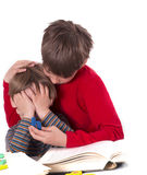 Older brother calms younger Royalty Free Stock Photo