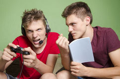 Older brother cant study from the noisy young brother Stock Photos