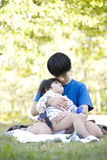 Older brother comforting little boy Royalty Free Stock Photo