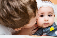 Older brother kissing his baby sister Royalty Free Stock Image
