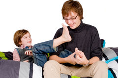 Older brother is tickling the young one Royalty Free Stock Images
