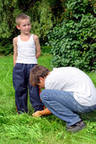 Older Brother Tying Shoelaces Royalty Free Stock Photos