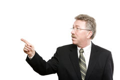 Older business man pointing away Royalty Free Stock Photo