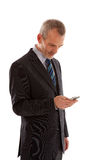 Older business man with smart phone. Over white background Stock Image
