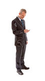 Older business man with smart phone. Over white background Royalty Free Stock Image