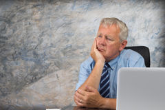 Older business man. Business man stressed and under pressure, selective focus stock images