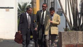 Older Business Men Walking. On Sidewalk Stock Photo