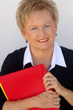 Older business woman with file folders royalty free stock image