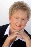 Older business woman portrait. A casual portrait of a beautiful older smiling business woman stock photos