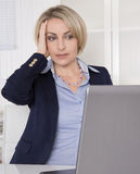Older business woman with problems at work. Stock Images