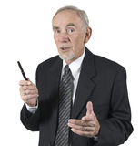 Older businessman discussing. Studio shot of senior businessman gesturing with pen during discussion or lecture. Isolated on white background Royalty Free Stock Images