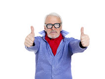 Older businessman giving thumbs up Royalty Free Stock Image