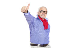 Older businessman giving thumbs up Stock Photo