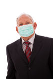 Older businessman with a mask Stock Photo