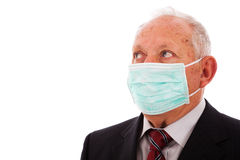 Older businessman with a mask Royalty Free Stock Image