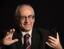 Older businessman with smart phone stock images