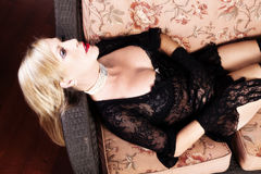 Older Caucasian Woman Black Lace Lingerie And Gloves Reclining O Royalty Free Stock Images