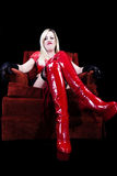 Older Caucasian Woman Sitting Making Face Red Latex Boots Royalty Free Stock Photography