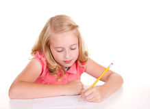 Older child or teenager doing math. Older girl or teen sloving math problems Stock Image