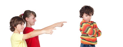 Older children laughing at a toddler angry Stock Photo