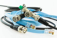 Older coaxial ethernet cable with BNC terminals and new with RJ4 Royalty Free Stock Photography