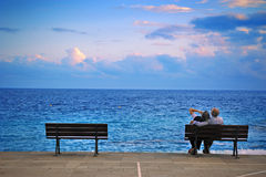 Older couple on a bench feelings of love Stock Photos