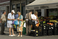 Older couple buys fruit in a shop, city Porto. Portugal: In the historical center of the city is the store, Casa Oriental. In front of this store are crates of Stock Image