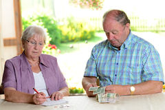 Older couple calculating her budget Stock Photos