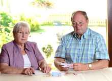 Older couple calculating her budget Royalty Free Stock Photo