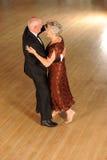 Older couple dancing. Older, senior or elderly couple dancing on open dance floor Royalty Free Stock Images