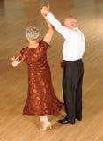 Older couple dancing. Older, senior or elderly couple dancing on open dance floor Royalty Free Stock Photography
