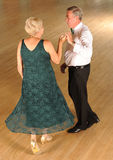 Older Couple at Formal Dance. Older couple in evening dress performing a ballroom dance Stock Photos