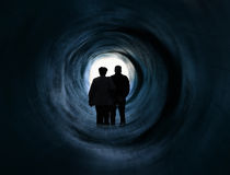 Older couple in front of white light tunnel end