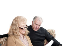 Older couple going over accounts Royalty Free Stock Images