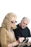 Older couple going over expenses Stock Images