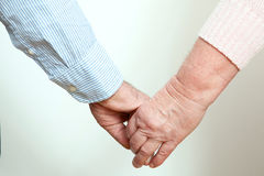Older Couple Holding Hands on white background. Older Couple Holding Hands close up on white background Stock Photography