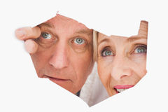 Older couple looking through rip Stock Photos